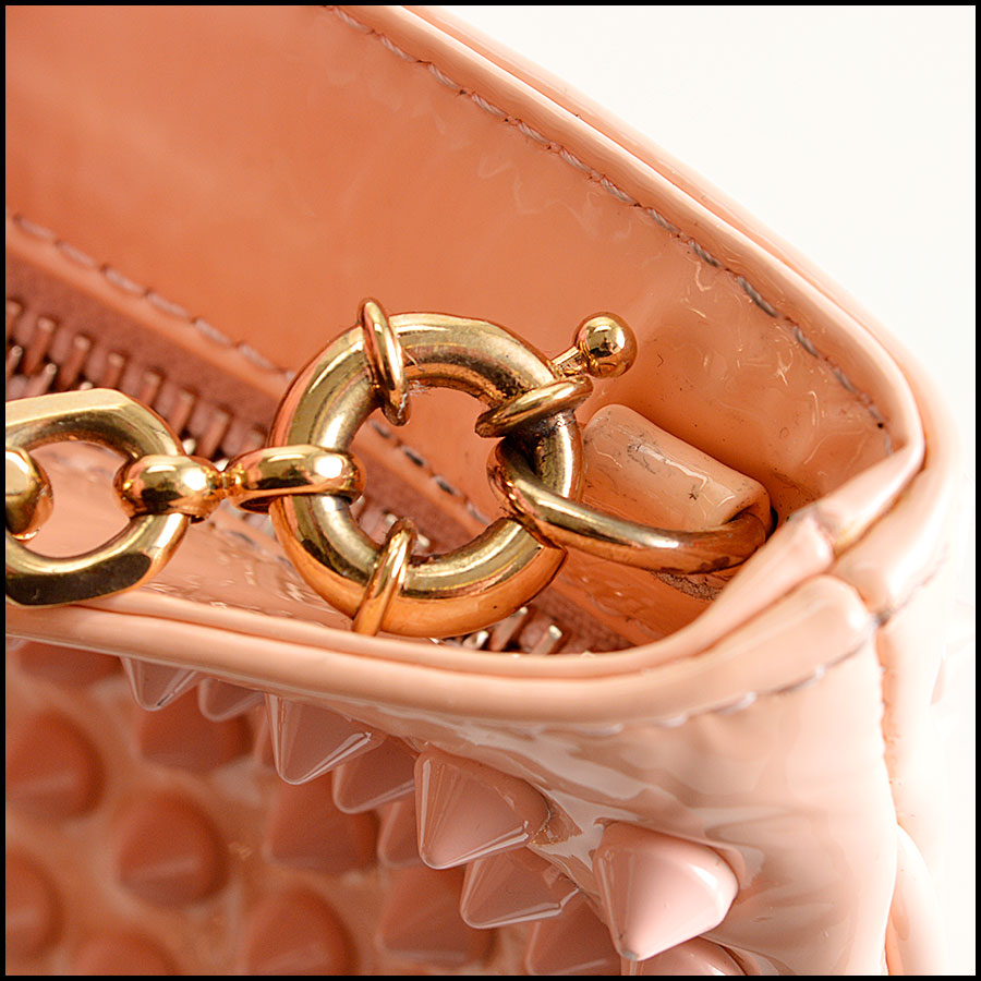 RDC8110 Louboutin Baby Pink Loubiposh Spiked Clutch close up