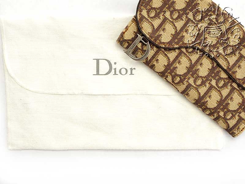 Dior Monogram Gaucho Wallet Includes