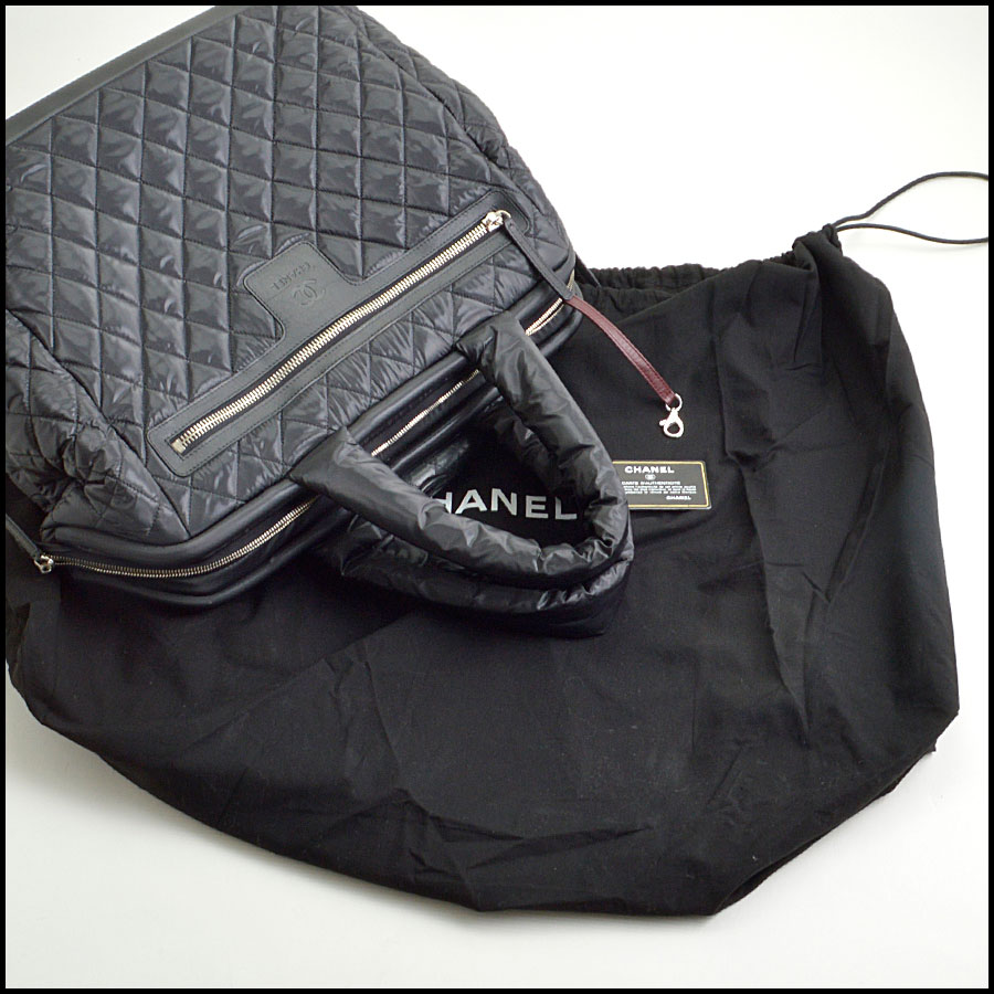 RDC8923 Chanel Rolling Luggage includes