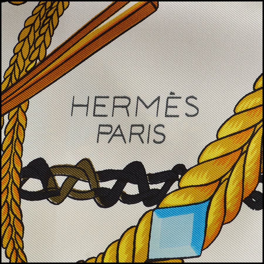 RDC8624 Hermes Ivory and Blues Le Timbalier Scarf logo