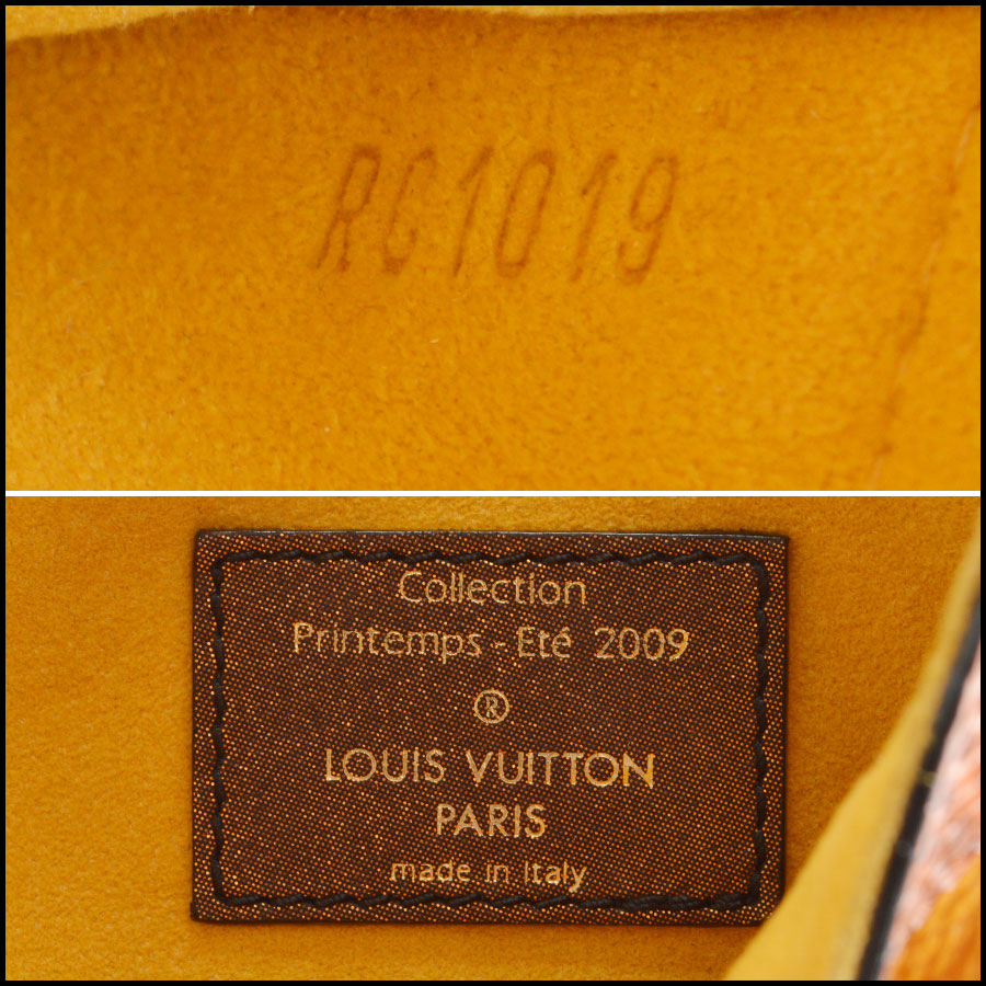 Louis Vuitton Leather Kalahari Handbag logo tag