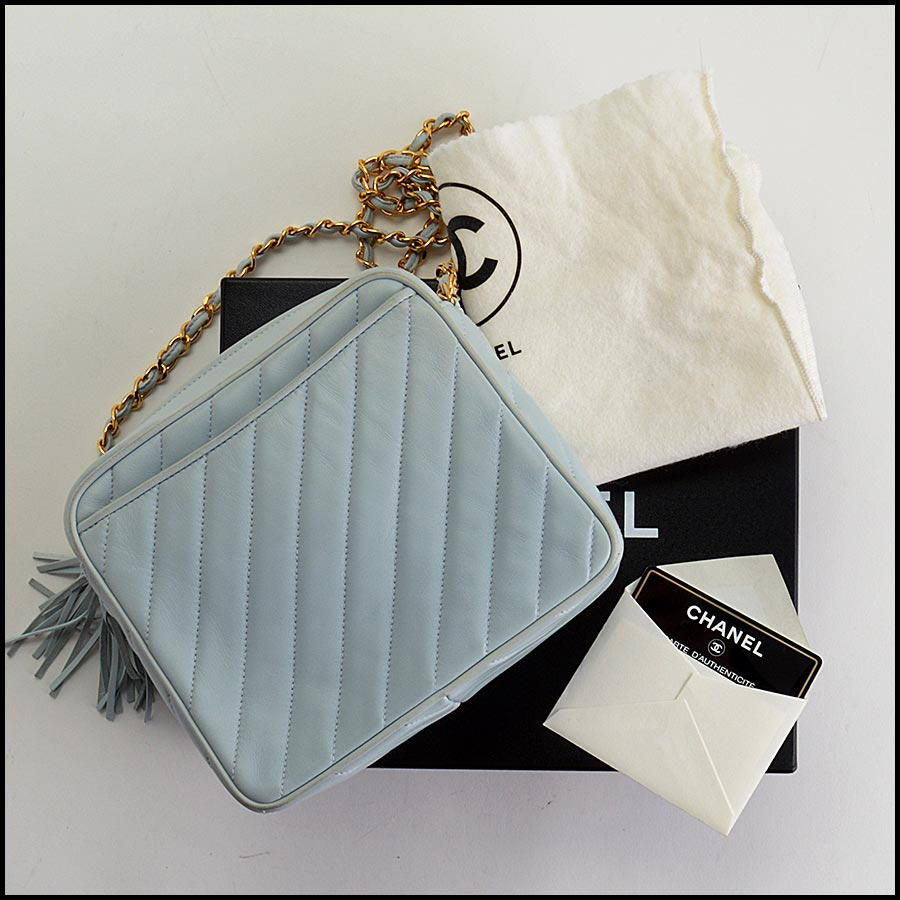 RDC11212 Chanel Light Blue Square Quilted Camera Bag includes
