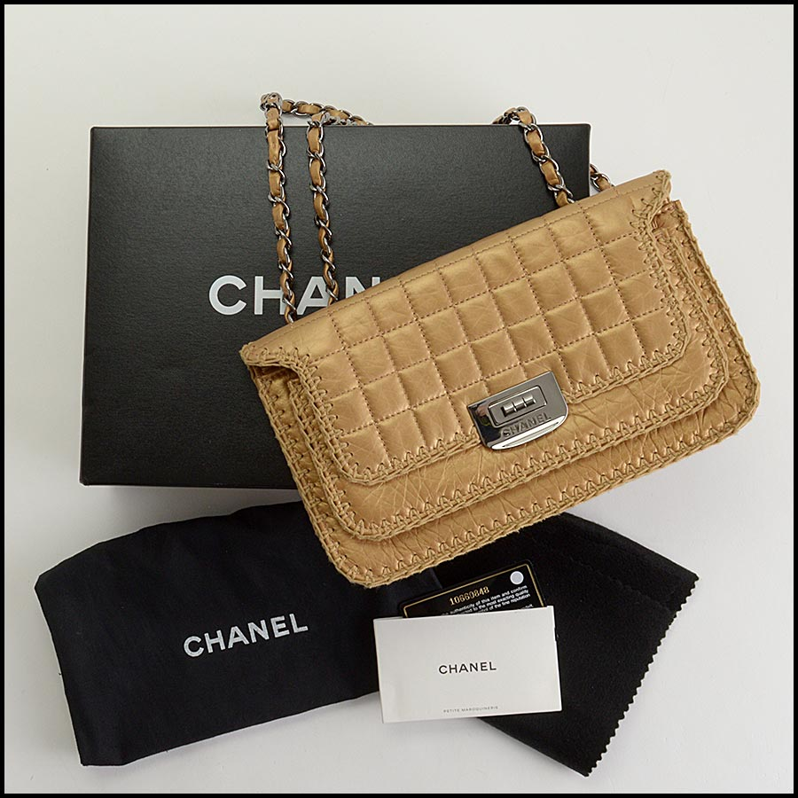 RDC11210 Chanel Gold Reissue Mademoiselle Turnlock Bag includes