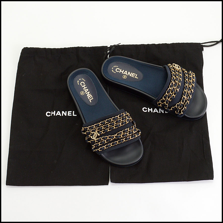 RDC10385 Chanel Navy Tropiconic Chain Slides includes