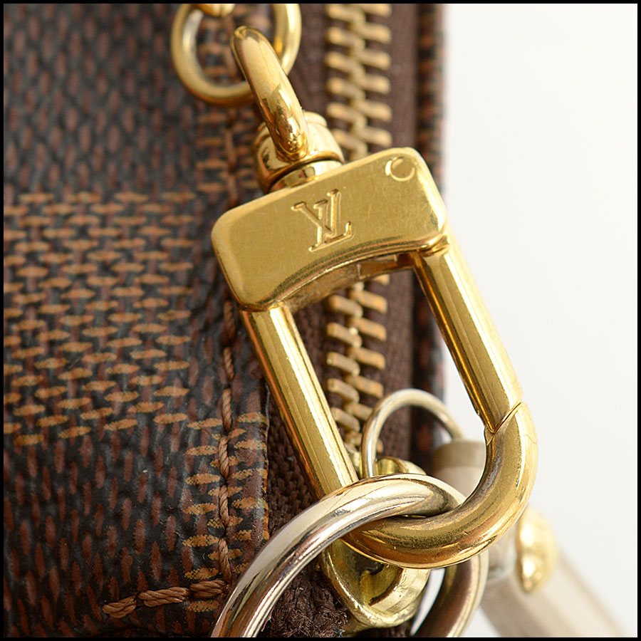 RDC10696 Louis Vuitton Damier Ebene Mini Pochette Bag close up