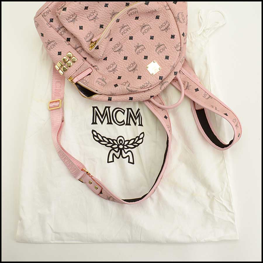 RDC11480 MCM Pink Coated Canvas Studded Backpack includes