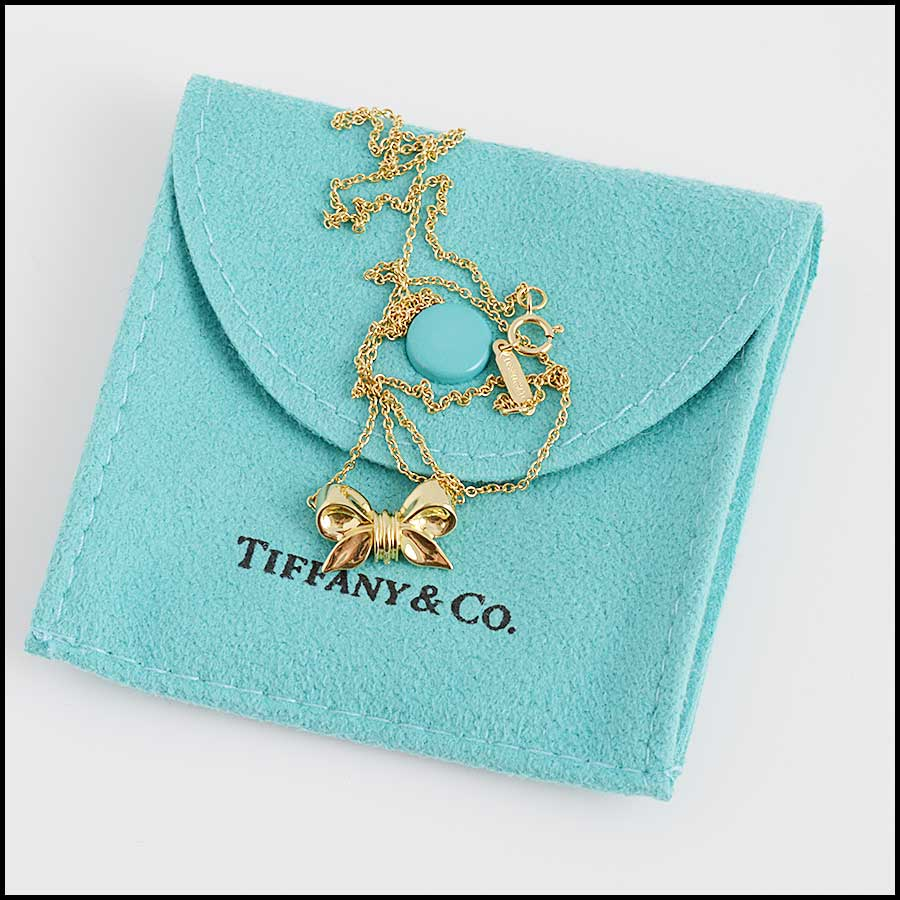 RDC11320 Tiffany & Co. 18K Gold Bow Pendant Necklace includes